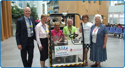 A motorised buggy is now running in the atrium of the Brunel building at Southmead Hospital Bristol.  Patients and visitors with mobility problems or those who struggle to walk long distances can now get a lift to their appointment on the buggy.