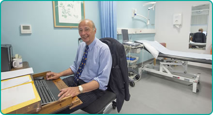 Mr Zenon Rayter in consulting room