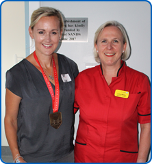 Rachael Senneck sporting her Virgin London Marathon medal, with Matron Cathy Molloy in the refurbished Maple Suite at Southmead Hospital