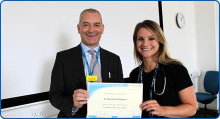 Medical Director Chris Burton with Trainee of the Year Charlotte Thompson