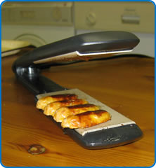 Sausages cooked on hair straighteners