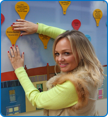 Spice girl Emma Bunton adds her balloon to the Mum's the Word mural