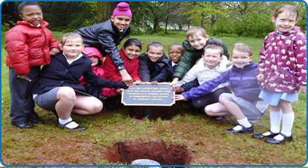 Children from Frenchay C of E School bury a time capsule at Frenchay Hospital